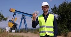 Cheap Petroleum Installation Trustful Engineer Man Showing Money US Dollar Bills Stock Footage