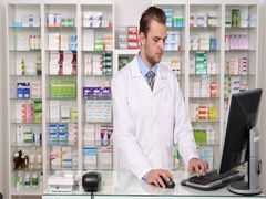 Young Pharmacist Man Talking Landline Phone Company Distribution Pharmacy Shop Stock Footage