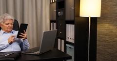 Elderly Woman Portrait Browsing Digital Tablet Use Modern Technology Home Office Stock Footage