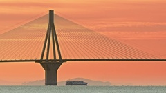 Famous Rio Antirrio bridge silhouette sky horizon travel ship landmark Greece Stock Footage