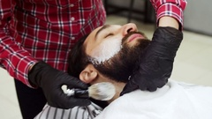 Barber applied to the face shaving foam by a swab Stock Footage