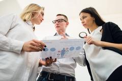 Business team discussing some charts. Bottom View Stock Photos