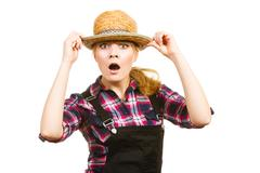 Portait surprised woman wearing hat and dungarees Stock Photos