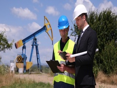 Businessman Explaining Oil Pump Installation Work Activity Talking to Engineer Stock Footage