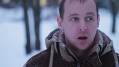 Man was out of breath in the winter on the street Stock Footage