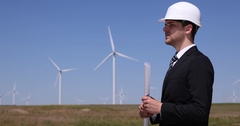 Business Men Talking About Teamwork Power Generator and Discussing Wind Turbine Stock Footage