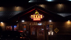 4K Texas Roadhouse BBQ steak restaurant, customer entrance Stock Footage