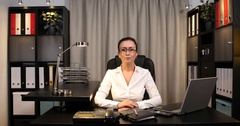 Real Estate Manager Woman Talking and Look to Camera Live Announcement in Office Stock Footage
