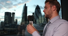Banker Businessman Holding and Counting Euro Bills Cash Salary London Skyline Uk Stock Footage