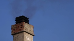 Smoke from house chimney on winter day Stock Footage