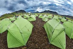 Trekking in Iceland. camping with tents near mountain lake Stock Photos