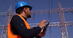 Inspector Engineer Man Use Digital Tablet Navigate Examine Electric Pylon Energy Stock Footage