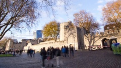 London Tower time lapse zoomout - crowds of tourists moving around, autumn day Stock Footage