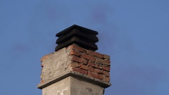 Smoke from house chimney Stock Footage