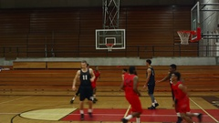 A basketball player makes a slam dunk during a game Stock Footage