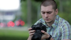 Young Man Taking Pictures At A Professional Digital Slr Camera Stock Footage