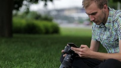 Man sets the camera before taking a picture with your smartphone Stock Footage