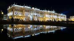 Impressive Winter Palace building illuminated at night, clear reflection Stock Footage