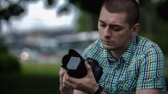 Man sets the camera before taking a picture Stock Footage