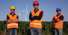 Engineer Team Men Posing Confident Looking at Camera on Wind Turbines Farm Field Stock Footage