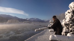 Winter Fisherman Struggling With Big Fishing Rod Stock Footage