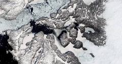 High-altitude overflight aerial of fast receding Jakobshavn Glacier, Greenland Stock Footage