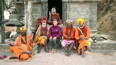Group of Sadhus posing for photo with tourist at Pashupatinath Temple Stock Footage