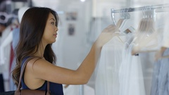 4K Cheerful couple shopping, looking at clothes in boutique clothing store Stock Footage