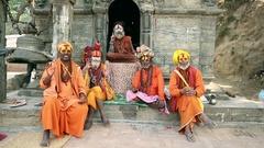 Group of Sadhus sending greetings, Pashupatinath Temple, Kathmandu Stock Footage