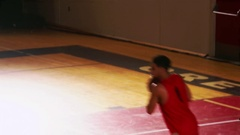 Basketball players passing the ball during a game and making a basket Stock Footage