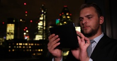 Successful Businessman Using a Digital Tablet Check Brexit Crisis London Skyline Stock Footage