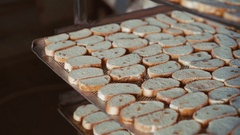 Close up of many fresh toasts with raisins in 4K Stock Footage
