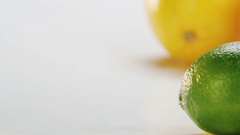 Limes and Oranges. Camera Moving From Left to Right Stock Footage