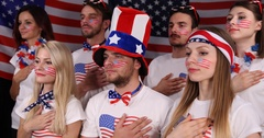 Portraits of Enthusiastic American Supporters People Listen National USA Anthem Stock Footage