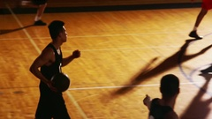 Two basketball teams each make a basket during a game Arkistovideo