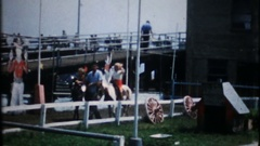 Children on pony rides at the amusement park, 3843 vintage film home movie Stock Footage