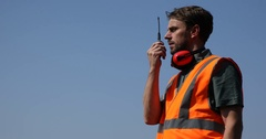 Airport Worker Man Communicating Over Walkie Talkie Telecommunication Equipment Stock Footage