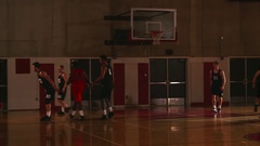 A basketball player makes a rebound basket during a game Stock Footage