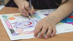 Child draws the pictures in the copybook Stock Footage