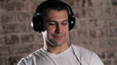 Relaxing music time. Portrait of mature man in headphones listening to music Stock Footage