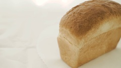 Close up of wheat bread on the white background in 4K Stock Footage