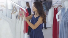 4K Beautiful female customer shopping in fashionable boutique clothing store Stock Footage