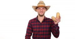 Confident Gardener Man Holding Bio Brown Potato Market Products Positive Ok Sign Stock Footage