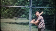 Man swings the bat but cannot hit the baseball, 3842 vintage film home movie Stock Footage