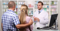 Pharmacist Man Talking Young Couple Patient Promote New Pills Medicine Pharmacy Stock Footage