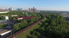 Moving suburban electric train on the bridge near the junction Stock Footage