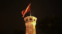 Tower with flag in Hanoi City. Night. Vietnam Stock Footage