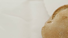Close up of wheat bread on the white background Stock Footage