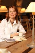 Lady with acne scars holding cup of coffee Stock Photos
