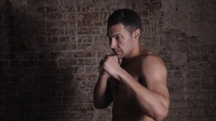 Young muscular sports guy with a naked torso boxing. Man healhy lifestyle Stock Footage